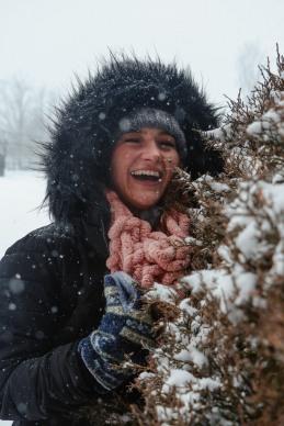 Snow smiles.