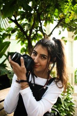 She loves her camera.